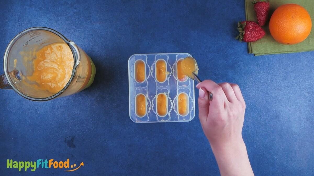 Zuckerfreies Fruchteis orange Schicht pürieren und hinzugeben